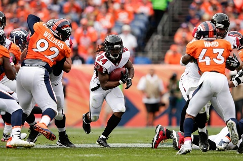 9598961-sylvester-williams-t-j-ward-devonta-freeman-nfl-atlanta-falcons-denver-broncos
