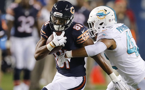 Chicago Bears wide receiver Cameron Meredith (81) is tackled by Miami Dolphins linebacker Spencer Paysinger (42) during the second half of an NFL preseason football game in Chicago, Thursday, Aug. 13, 2015. (AP Photo/Charles Rex Arbogast)